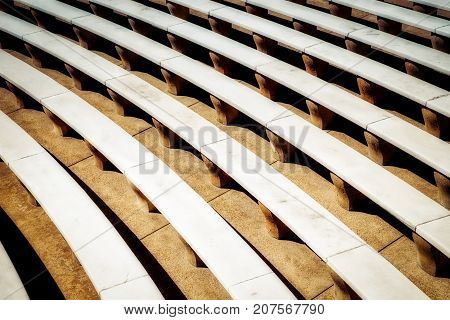An outdoor auditorium in Virginia with rows of marble seating.