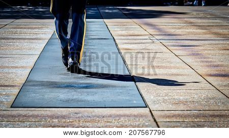 A member of The Old Guard on duty and walking the mat at Arlington National Cemetery. at Arlington National Cemetery.