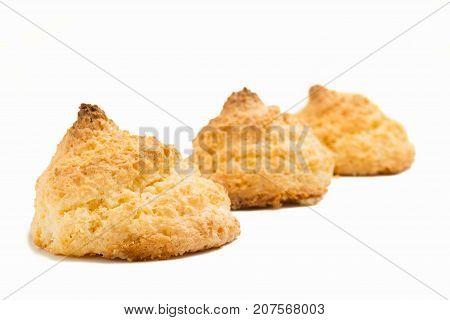 Delicious spanish coconut meringue cookies (coconut macaroons or sultanas de coco) on white background