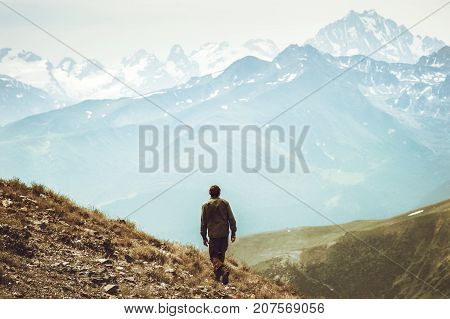 Man hiking at mountains landscape Travel Lifestyle wanderlust adventure concept summer vacations outdoor into the wild