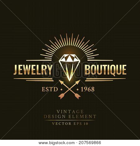 Gold vintage retro badge wit diamond arrows and sunburst on the black background. Jewelry boutique logo