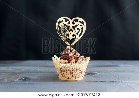 Adorned with gold topper cupcakes on the table