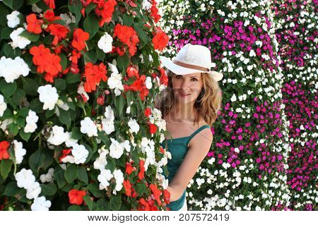 Young Girl Summer Outdoor Portrait, Model Peep out behind Flower Background
