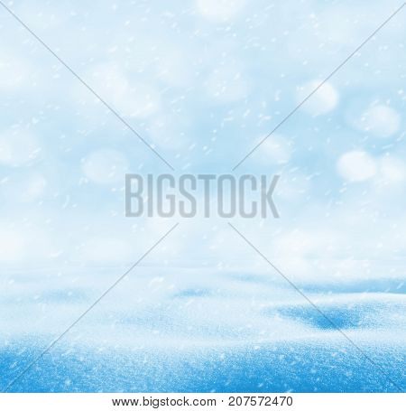 Winter bright landscape with snowdrifts and falling snow.