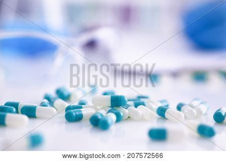 Tablets scattered on the table of the pharmaceutical laboratory pill for the prescription and treatment of various diseases chemistry