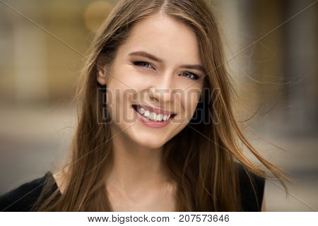 Young beautiful smiling girl. Natural beauty, woman with perfect smile.