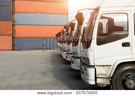 Container truck in depot at port. Logistics import export background and transport industry concept.