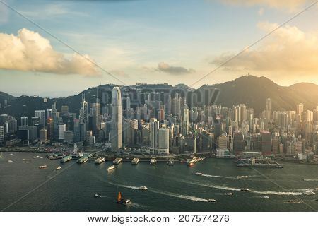 Aerial view of Hong Kong skyline and Victoria Harbor with blue sky in Hong Kong. Asia.