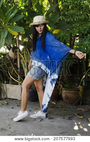 Asian Thai Woman Wearing Indigo Art Clothes For Show And Portrait At Garden