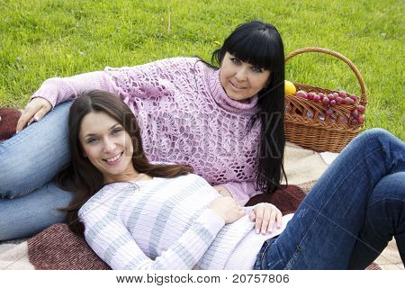 Mother and daughter relaxing park