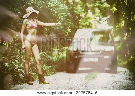 Hitchhiker Woman In Bikini On The Road