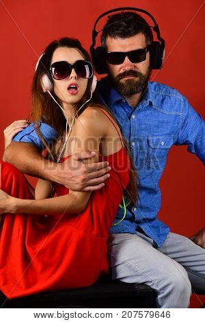 Relax, Party And Music Concept. Couple In Love Wears Headphones