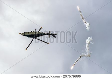 SLiAC SLOVAKIA - AUGUST 27: Helicopter Augusta A-109 and flares at airshow SIAF 2017 on August 27 2017 in Sliac