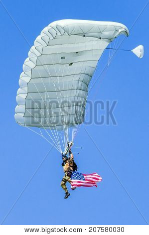 SLIAC SLOVAKIA - AUGUST 27: Parachutist with waving american flag at airshow SIAF 2017 on August 27 2017 in Sliac