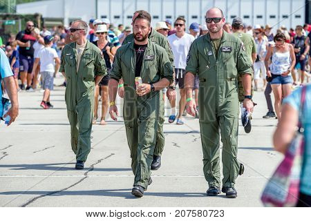 SLIAC SLOVAKIA - AUGUST 27: Pilots in overall walking on runway at airshow SIAF 2017 on August 27 2017 in Sliac