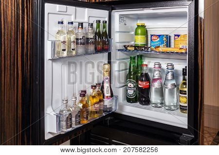 Moscow, Russia - February 23, 2017: mini bar with soft drinks, vodka, wine and beer in the hotel room at Crown Plaza