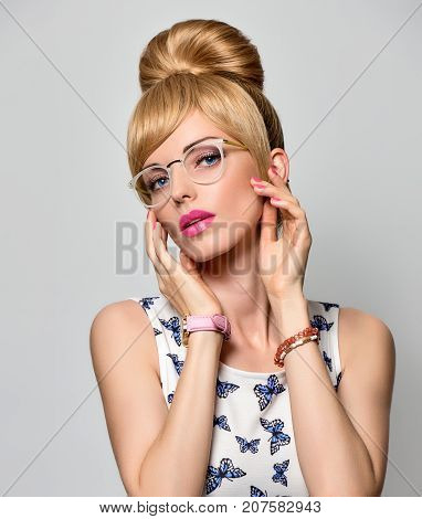 Fashion Portrait Young Blond Woman in Stylish glasses, Summer Outfit. Stylish Trendy Pinup hairstyle, fashion Glamour Makeup, Blue Eyes. Pretty Model Girl in Butterfly summer Dress. Beautiful lady
