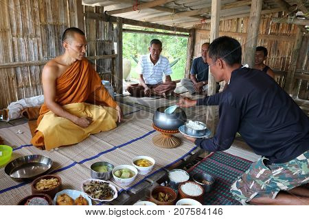 Local people are offering food to the monks in the bamboo hut at fisherman's Village Samui Thailand April 27 2017