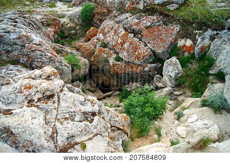 Small entry of a big cave in Tangerian steppes near lake Baikal, Russia