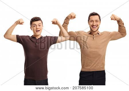 Teenage boy and a young man flexing their biceps and looking at the camera isolated on white background
