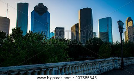 Houston , Texas , USA skyline Cityscape at Sabine Street Bridge rising Skyscrapers downtown morning sunrise reflections off buildings at golden hour
