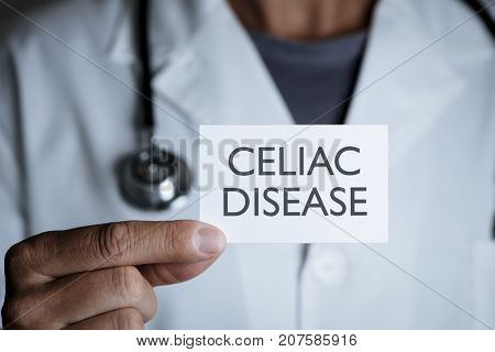 closeup of a young caucasian doctor man in a white coat showing a signboard with the text celiac disease written in it