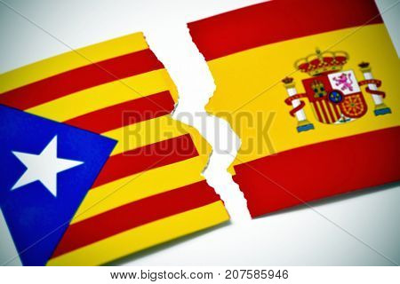 the Estelada, the Catalan pro-independence flag and the flag of Spain, broken on an off-white background, with a slight vignette added
