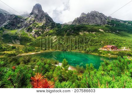 Tarn Zelene pleso and cottage in High Tatras mountains at Slovakia. Alpine summer mountainscape