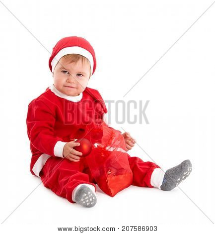 Toddler boy in Santa Claus costume looking at camera isolated on white background.