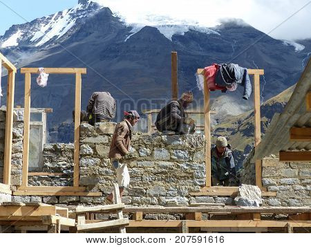 Tilicho Base Camp Nepal september 14 2015: Nepali workers building house - Meeting local people during Annapurna Circuit trek