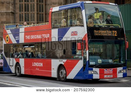 London 28th September 2017:-A Union Flag decorated London tour bus near the Palace of Westminster