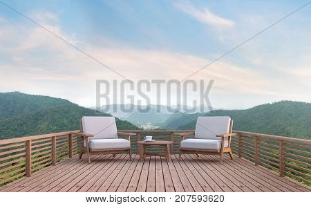 Wood balcony with mountain view 3d rendering image. There are wood floor.Furnished with fabric and wooden furniture. There are wooden railing overlooking the surrounding nature and mountain