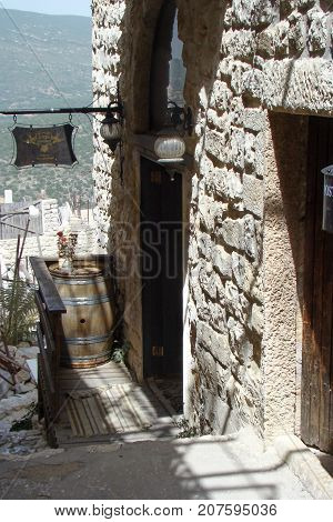 View in a historic street in the Israeli city of Safed with an old wine barrel