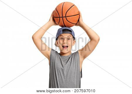 Happy kid holding a basketball and looking at the camera isolated on white background