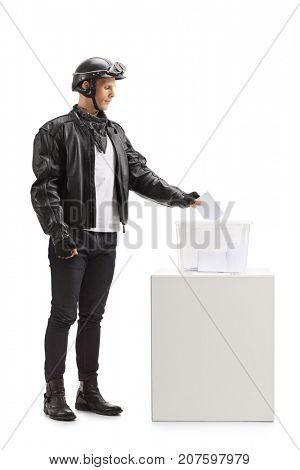 Full length profile shot of a biker casting a vote into a ballot box isolated on white background