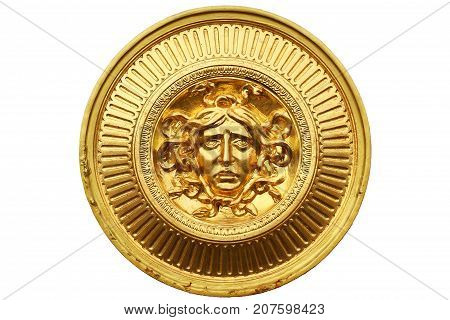 Ancient golden warrior shield isolated on white background, circle glossy steel shield with face of human one of important for solider protection, knight
