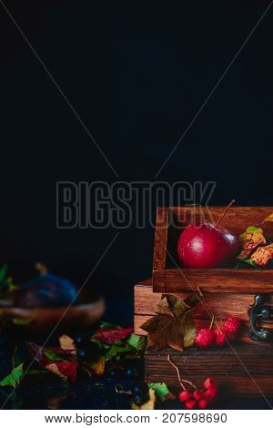 Apple In A Wooden Crate. Dark Food Photography With Copy Space.
