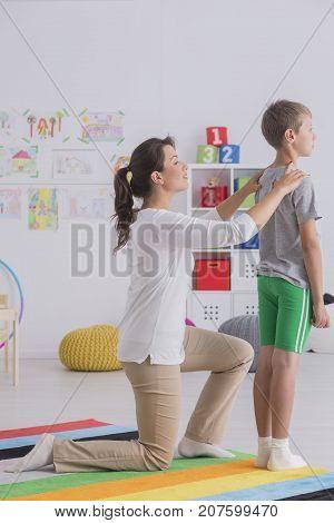 Female Physiotherapist Helps Boy