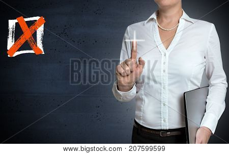 Checkbox touchscreen is shown by businesswoman pictures