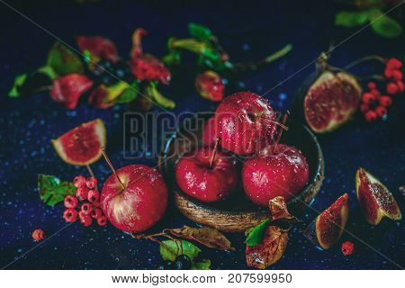 Ripe Sweet Apples In A Wooden Plate Close-up In An Autumn Still Life With Fallen Leaves. Autumn Harv