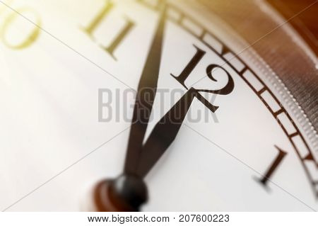 Photo of clock showing five minutes to noon Toned