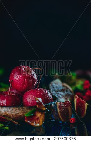 Harvest Concept With Red Miniature Apples Close-up In An Autumn Still Life With Fallen Leaves. Dark
