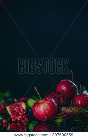Tiny Red Miniature Apples Close-up In An Autumn Still Life With Fallen Leaves. Dark Food Photography