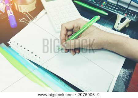 Male's hand is about to take note or orders in the workplace
