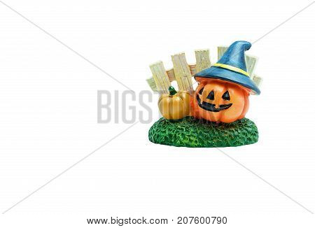 Halloween concept : Ceramic pumpkins on green grasses and fence isolated on white background