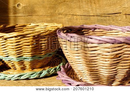 Empty basket with checked tablecloth on wooden table over grunge background. side view. close-up