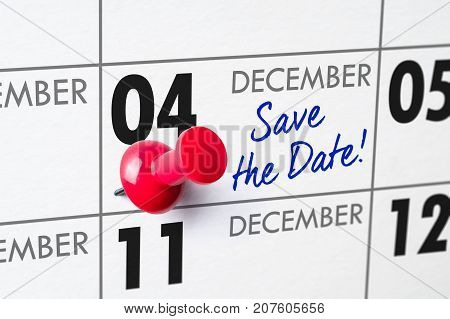 Wall Calendar With A Red Pin - December 04