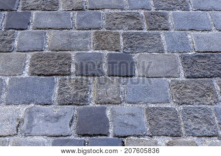 Urban paving stones. It can be seen laying cobblestones.