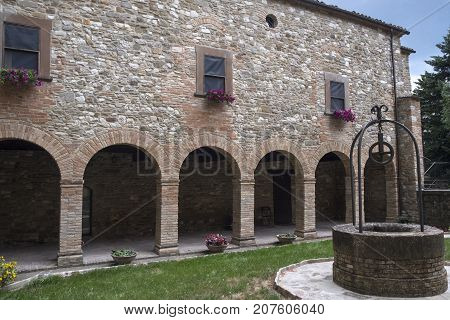 The medieval church (pieve) of San Giovanni Battista at Carpegna (Montefeltro Pesaro Urbino Marches Italy). Cloister
