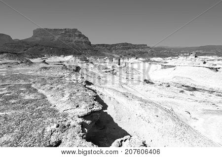 Rocky hills of the Negev Desert in Israel. Breathtaking landscape of the desert rock formations in the Southern Israel Desert. Black and white picture